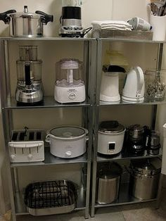 """I so """"NEED"""" these shelves in my kitchen for all my small appliances.Organize small appliances on open shelving units - would be great to put in the pantry to reduce the look of clutter around the kitchen. Steel shelves are from Ikea. Ikea Kitchen Shelves, Ikea Shelves, Ikea Storage, Kitchen Cabinets, Garage Storage, Hanging Storage, Garage Cabinets, Diy Cabinets, Food Storage"""