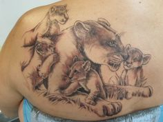 lioness and cubs - 50 Examples of Lion Tattoo | Art and Design