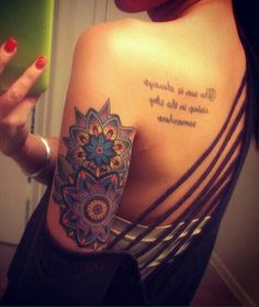 Colorful mandala arm tattoo. Mandala tattoos are often in very brightly colored shades to promote positivity and femininity for women.