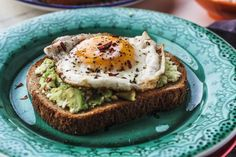 Avocado Toast with Egg combines healthy whole wheat toast, a creamy avocado and cottage cheese spread and a fried egg. It is pretty simple and absolutely delicious. We like to add a little diced tomato on top. Thanks to blackberrybabe.com for sharing.