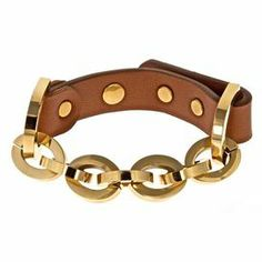 Chain and tan leather bracelet with gold-hued studs.  Product: BraceletConstruction Material: Leather, zinc, tin and gold platedColor: Tan and goldFeatures:  Post and hole closureAdjustable Cleaning and Care: Keep away from any forms of moisture, lotions, or chemicals. Keep in plastic baggies to avoid tangling and tarnishing.
