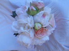 Large round Bridal bouquet made of Peonies blush pink , ivory and white roses Free groom bout Cascade Bouquet, Pink Bouquet, White Roses, Peonies, Wedding Bouquets, Blush Pink, Floral Wreath, Groom, Ivory