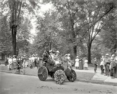 "Detroit, 1901. ""Bicentenary celebration floral parade -- automobile of William Metzger."" 8x10 inch glass negative, Detroit Publishing Company."