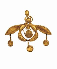 Two bees arranged about a honey comb, gold pendant with appliqué and granulated ornament. Mallia, Crete, Greece. 1700-1550 B.C. (Middle Minoan). | Heraklion Archaeological Museum