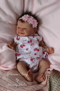 Roxy is now available to order at www.dollconnectionstore.com or call us toll free 1-866-817-0795 One of the most beautiful full body silicone smiley baby girl you will ever find! Extended layaway on Roxy, she is just gorgeous!!!