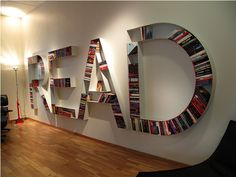 """READ bookshelf- Literally spells the word """"READ"""" on the wall! :) Great reminder to turn off that tv, huh?"""