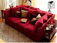 Sofa configuration from bassett but adding one more armless across the back and one more ottoman