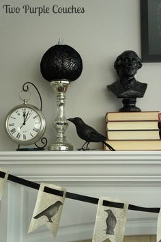 Create a spooky literary-inspired mantel with stacks of old books, a book page banner, and a raven. via www.twopurplecouches.com
