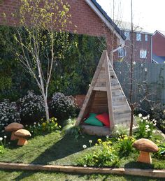 ITV Love Your Garden TV makeover - wooden teepee with stars cut out in a woodland garden