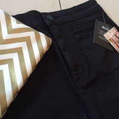 """BDG Super High Rise Pin Up Shorts NWT BDG Super High Rise Pin Up Shorts - Black Size 28 78% Cotton, 20% Polyester, 2% Spandex Inseam: approx 2"""" Waist: approx 14"""" Rise: approx 12.25""""  OFFERS WELCOME May trade for J. Crew Broken In Chino 5"""" in size 6. Open to different colors. Urban Outfitters Shorts"""