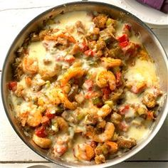 Ragin' Cajun Eggplant and Shrimp Skillet Recipe -We always have a large summer garden where lots of produce lingers into fall. That's when we harvest our onion, bell pepper, tomatoes and eggplant, the main ingredient of this dish. This recipe turns Cajun with the Holy Trinity (onion, celery and bell pepper), shrimp and red pepper flakes. —Barbara Hahn, Park Hills, Missouri