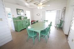 ahhh...love the green...looks like summer...dining room of a beach cottage on Sullivan's Island