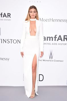 Gigi Hadid struck a pose in her gorgeous white dress at the amfAR Gala in Cannes. Check out even more stunning pictures of the blonde bombshell!