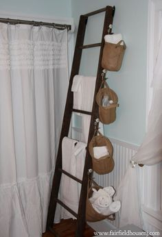 discovered the ladder in an outbuilding on the property when we moved in. I use it as a towel rack. Since I don't like storing things in the shower, I added numbered hooks purchased at Pottery Barn and hung burlap bags purchased from LaurieAnna's Vintage Home, thus creating a spot for shampoo, conditioner, wash clothes, hand towels and bath mats.