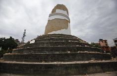 The historic Dharahara tower, a city landmark, stands destroyed after an earthquake in Kathmandu, Nepal, Saturday, April 25, 2015. A strong magnitude-7.9 earthquake shook Nepal's capital and the dense