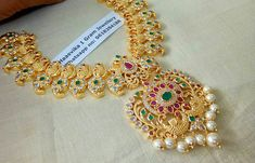 Price: Beautiful one gram gold necklace with mango hangings. Necklace with dancing peacock design pendant. Necklace studded with multi color CZS. Necklace with pearl hangings. For order processing what s app on 9618284188 26 April 2018 Indian Wedding Jewelry, Bridal Jewelry, 1 Gram Gold Jewellery, Cz Jewellery, Wholesale Gold Jewelry, Pearl Set, Jewelry Model, Imitation Jewelry, Gold Necklace
