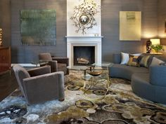 I've been contemplating a living room that mixes grey with brown - this one is interesting, I like the introduction of some greens and gold