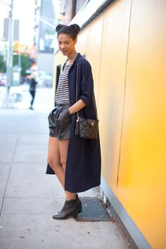 What We Can Learn From The New Model-Off-Duty Look #refinery29  http://www.refinery29.com/model-off-duty-outfits#slide1  Claire Millar mixes up the seasons with a pair of leather shorts and extra-long overcoat.