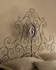 """""""Dayton"""" Monogrammed Headboard by Dr. Livingston at Horchow."""