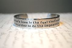A Mother's Love is the Fuel the Enables a Daughter to do the Impossible Custom Cuff Bracelet. $25.00, via Etsy.