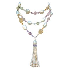 Baroque Pearl Sautoir with Multi Colored Stones | From a unique collection of vintage more necklaces at http://www.1stdibs.com/jewelry/necklaces/more-necklaces/