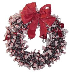 Tootsie Roll Wreath - I'm making this for the Chambers wreath auction and it's turning out really cute, but I can honestly say I would never make this again! I don't know what I was thinking! :0)