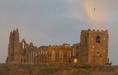 Whitby Abbey with it's gaunt, imposing remains, recently named Britain's most romantic ruin is set high on a cliff above the Yorkshire s. Fort Augustus, Whitby Abbey, The Loch, Victorian Cottage, Middlesbrough, Seaside Towns, North Yorkshire, Most Romantic, Walking Tour