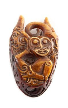 Indonesia ~ Borneo | Ornament from the Dayak people | Carved hornbill