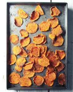 "Baked Sweet Potato Chips | Martha Stewart Living - Transform vitamin-packed sweet potatoes into a low-fat ""can't eat just one"" snack simply by tossing with a drizzle of olive oil, seasoning with cumin, paprika, and salt, and baking until crisp-edged."