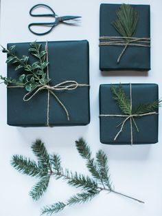 Christmas Wrapping using black paper and spruce branches