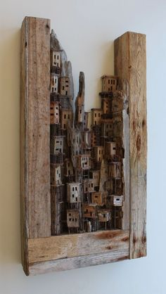 Shacks and ladders represents a village that is build against the rocks, consisting of shacks that can be reached through ladders. Sculptures Céramiques, Sculpture Art, Layered Architecture, Dazzle Camouflage, Fox Crafts, Architectural Sculpture, Driftwood Crafts, Cardboard Art, Wooden Wall Art