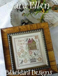 """Clara Ellen is the title of this cross stitch pattern from Blackbird Designs that is the eighth design in the """"Anniversaries of the Heart"""" series."""