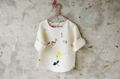 """Kids' Smock in """"Wild, Natural, Free"""" pattern designed by Lena Corwin"""