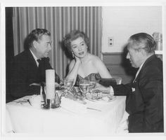 Greer Garson and her husband Buddy, taken in 1951 at the Palm Springs Racquet Club. The other gentleman in the picture is a long-time army friend of Buddy's, Colonel Paul.