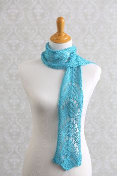 This sky blue scarf features an airy horseshoe lace motif throughout that's perfect for all your favorite spring outfits. Dazzle your friends with this simple project featuring an eight-row repeat and delicate design.