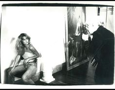 This is a real behind-the-scenes shot. Here, Andy Warhol is captured photographing Farrah Fawcett. His polaroid of the actress is a classic.