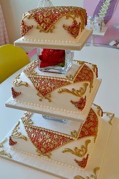 Asian Wedding cake  www.tablescapesbydesign.com https://www.facebook.com/pages/Tablescapes-By-Design/129811416695