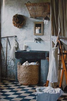 french farmhouse laundry room with French country decor. sink potting shed