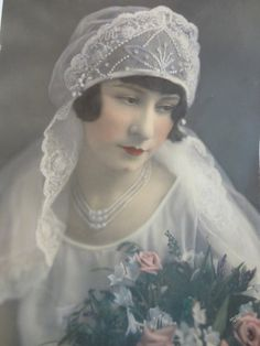 Hand-tinted photo of a 1920's bride