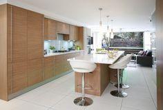 Fabulous island kitchen with bi-fold doors to garden