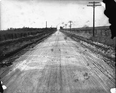 Kennedy Road, looking north from the farm of Alex Doherty : one mile south of Ellesmere, Scarborough Township. The modern street of Munham Gate would be located where the second-closest telephone pole stands.  Date	circa 1925-1940 Alexander W. Galbraith