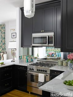 In this Chicago, Illinois, kitchen measuring only 105 square feet, high style means high contrast. Designer Summer Thornton sets a sophisticated tone with black and white. Add vintage treasures, some mirror, and — suddenly — a room sparkles.   - HouseBeautiful.com
