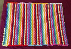 http://www.ravelry.com/projects/jlgarde/blackberry-salad-striped-baby-blanket