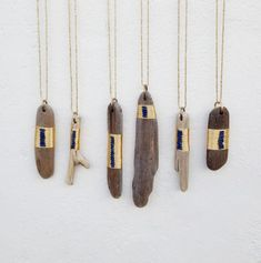 Driftwood Amulets with Lapis from SeeRealFlowers.