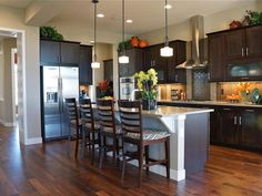 Similar layout; nice warmth in Kitchen with Breakfast Bar - 99 Beautiful Kitchen Island Design Ideas on HGTV