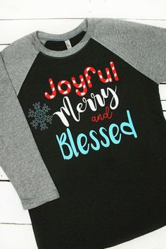 "To layer with leggings, order a size up. Add this ""Joyful, Merry, and Blessed"" raglan to your Christmas shirt collection!"