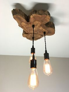 These beautiful and funky live-edge olive wood light fixtures are perfect for bedrooms, top of stairs, over kitchen sink... If you are looking to
