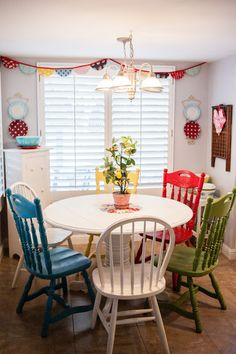 This would be such a good idea for a kids craft table! Have a small round table and paint the chairs different colors for kids to use for painting, drawing, or crafts.