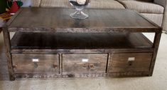 More Like Home: diy coffee table (Pottery Barn inspired) with storage.  Total cost about $60, plus drawer pulls.  Includes plans, shopping list, and full tutorial.  She also has tutorials for matching console and end tables.  LOVE.