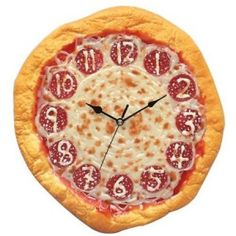 """Jumbo sized Arabic numbers have been cast from cheese. The hands depicting hours, minutes and seconds are all coloured black. The clock has a diameter of 12"""" and is operated by one AA battery."""